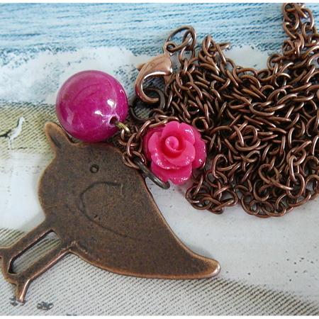 Koperen roze vogel
