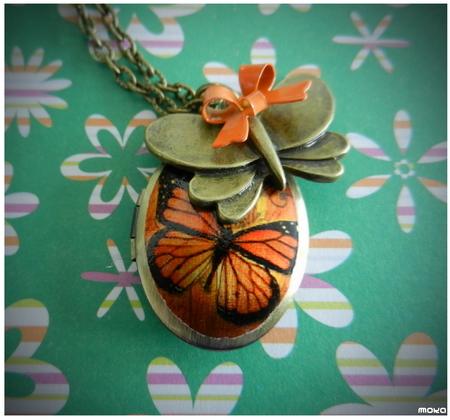 Oranje vlinder medaillon