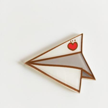 broche papieren vliegtuigje